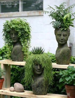 """different plants and cuts used to create fun """"haircuts"""" in these bust planters"""