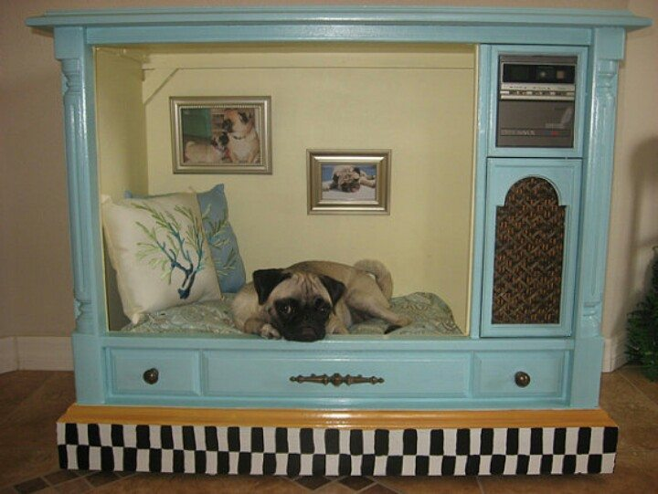 Old TV repurposed into a dog bed