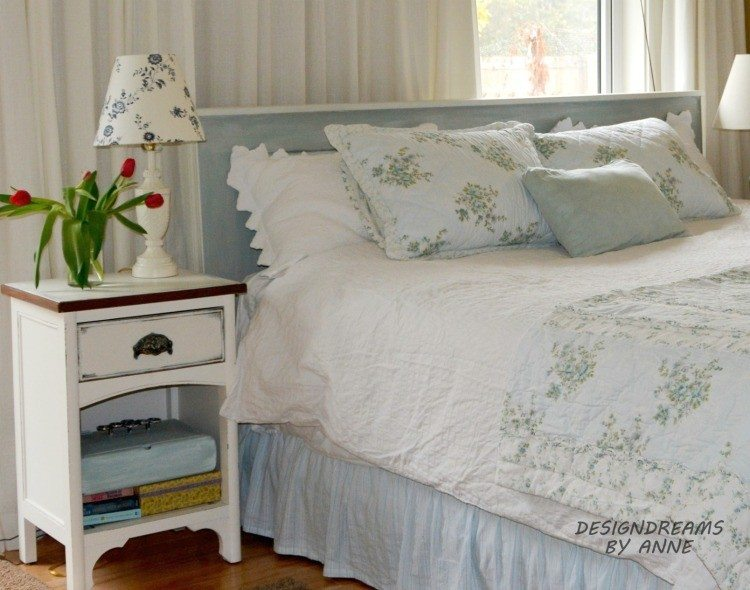 An old door upcycled into a headboard